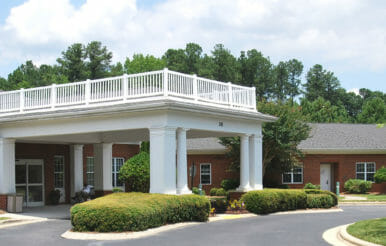 White terrace over a building entryway