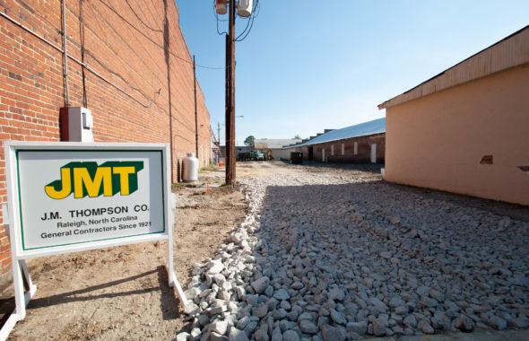 JMT sign outside a brick building